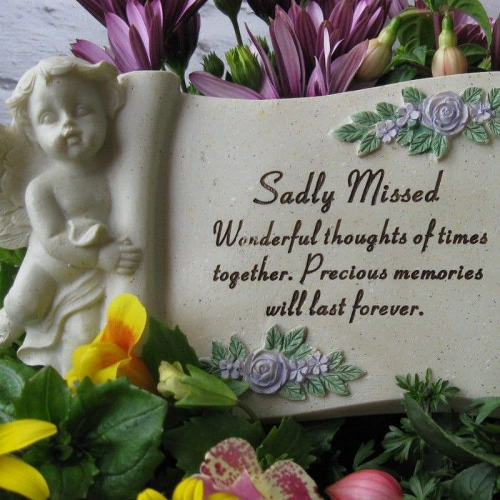 Graveside Angel Cherub Scroll  This is a memorial graveside Sadly Missed Cherub Scroll with the inscription:   Sadly Missed  Wonderful thoughts of times  together. Precious memories  will last forever.  Made from resin, this granite effect Graveside Scroll measures approximately 24cm x 11cm