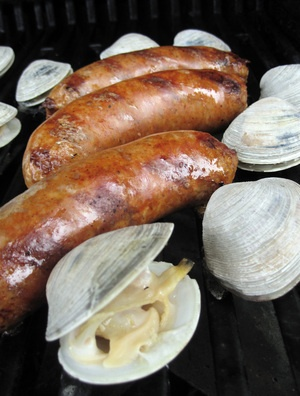 Grilled Clams And Chorizo (Curanto Al Disco) -- one of our favorites!