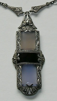Pendant, looks to be made with onyx, moonstone and something else...? Anyone with more info about this piece, please comment :)
