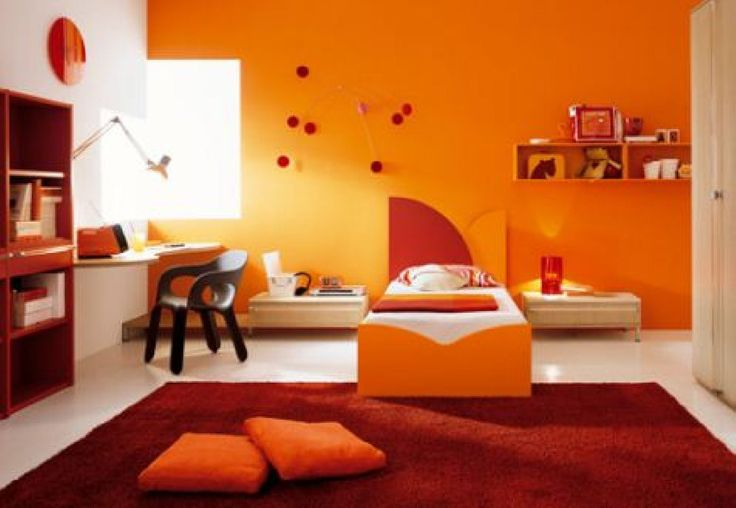 Warm Orange and White Poterry Barn Teen Room Design Gallery with Modern Bed Furniture complete with the Bedside Table also Floating Wood Study Desk that have Black Chair also Large Rectangle Red Rug on the White Tiles