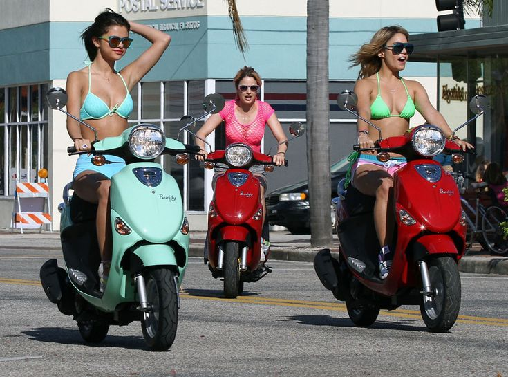Biker Bikini Girls from Selena Gomez's Sexy Swimsuit Pics  In Spring Breakers, Selena, Ashley Benson and Vanessa Hudgens don't need to bother getting dressed when they hit the town on their scooters!
