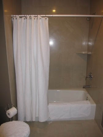Polished Porecilin Tile In Upper Bathroom Shower Walls And Floor For Clean  Look, Along With