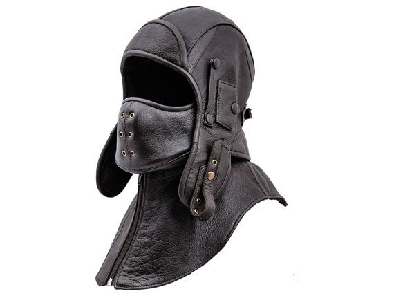 Sturdy, warm and comfortable aviator cap made with genuine leather. Collar is attached by zip fastener. Mask is attached with press studs. Both can be