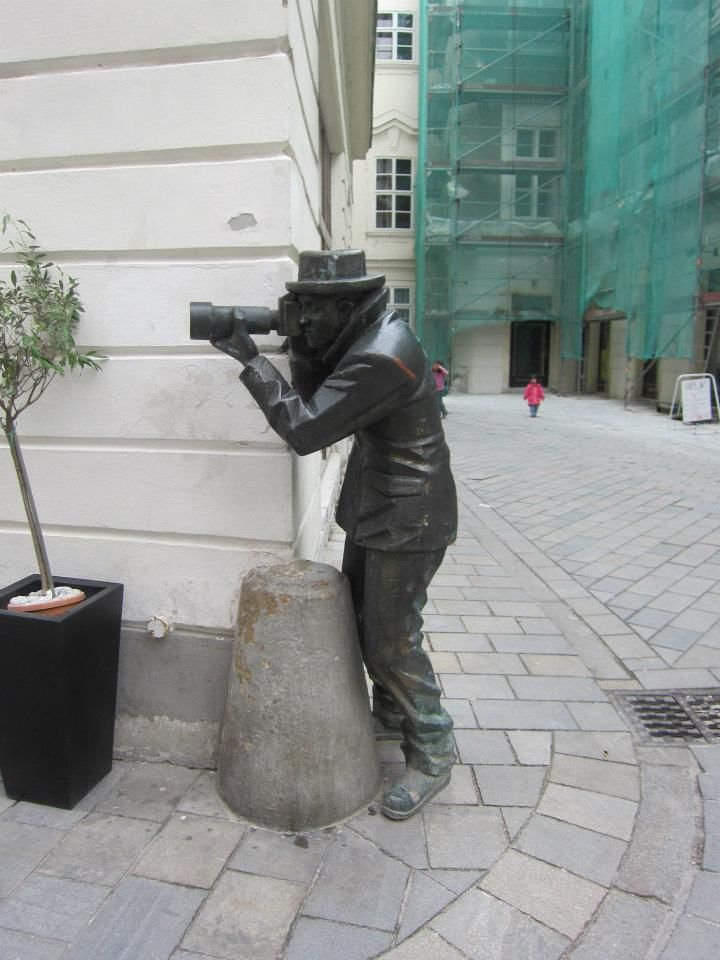 This statue is attached to an amazing restaurant in Bratislava, Slovakia called Paparazzi.