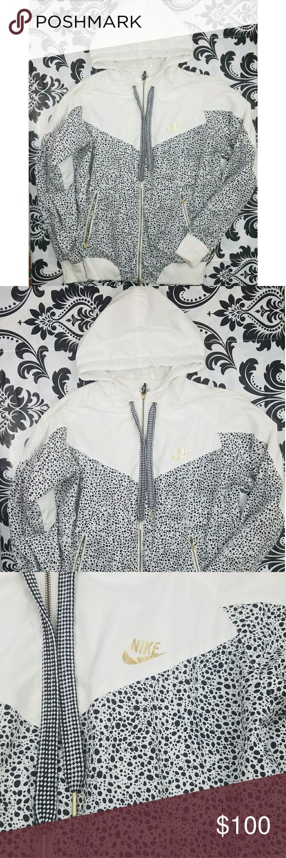 Nike black, white and gold zip up kurtka Women's Nike brand kurtka zip up light weight jacket  White with black polka dots all over  Gold detail throughout  Gold zipper down middle and on pockets  Gold Nike logo and black and white Nike tennis shoe on zipper Pre Owned good condition  Shoes small signs of wear overall good condition  Women's Size large Nike Jackets & Coats
