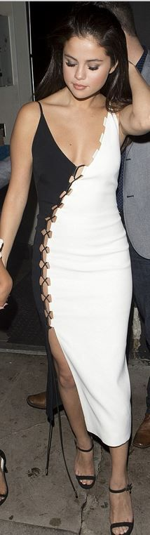 Who made  Selena Gomez's white and black lace up dress?