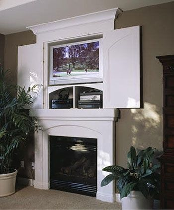 above fireplace tv hideaway... Oh I think this may be the hubby's next project!!!