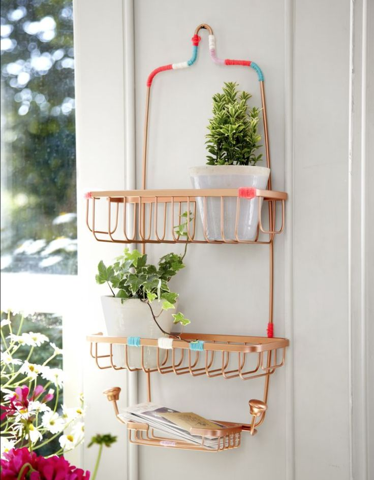 A fresh coat of gold paint and strategically placed string decoration makes this shower caddy feel like a chic entryway accessory. A