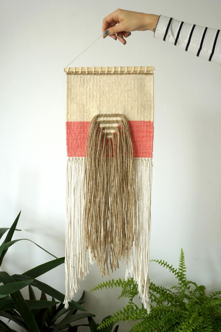 This is an minimalist wall hanging made of high quality cotton, yute and recycled woolen yarns - leftovers from one of the polish carpets factories. The item was ethically made in Poland with all the precision and attention to details. It can be a beautiful and unique decoration.  Please notice tha