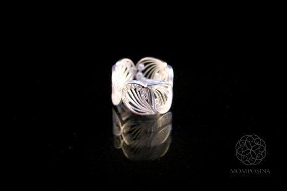 Woven silver filigree flower petal ring.
