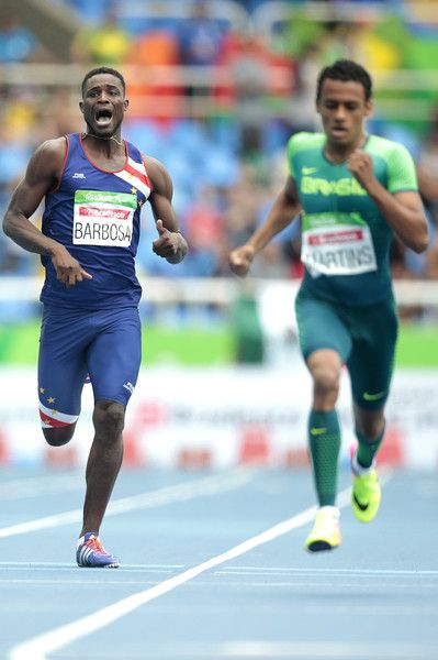 (L-R) Gracelino Barbosa of Cape Verde and Daniel Martins of Brazil in action during the Men's 400m - T20 Final at the Olympic Stadium on Day 2 of the Rio 2016 Paralympic Games on September 9, 2016 in Rio de Janeiro, Brazil.