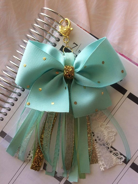 Add a little glam to your planner or even your keychain or purse! This is a unique, one of a kind item with a gold plated heart clasp that you or any planner lover will enjoy. Every piece of ribbon was hand picked by me ^.^ ♥ ♡ ♥ ♡ ♥ ♡ ♥ ♡ ♥ ♡ ♥ ♡ ♥ Pictured with an Erin Condren Life