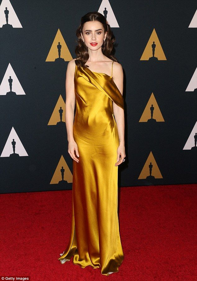 Gorgeous: The actress teased at her lithe figure in the off-the-shoulder backless dress...
