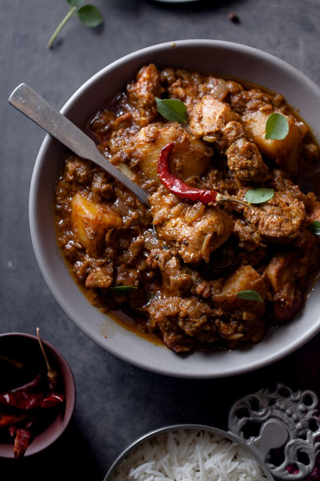 VINDALOO ~~~ the beloved dish, vindaloo morphed from carne de vinha d'alhos. classic and anglo-indian versions follow: this post's link + http://www.bbc.co.uk/food/recipes/lamb_vindaloo_41903 + http://food52.com/recipes/23834-chicken-vindaloo-vesuvius + http://www.thetiffinbox.ca/2011/11/vindalho-de-galinha-chicken-vindaloo.html + http://www.saveur.com/article/Recipes/Classic-Chicken-Vindaloo [India, Goa] [England, Anglo-Indian Cuisine]