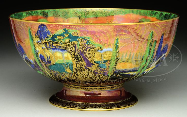 WEDGWOOD FAIRYLAND Wedgwood Fairyland Lustre punch bowl is decorated on exterior in Poplar Tree pattern with tall poplar trees, bridge crossing river and gilded tiny flowers surrounding ground. Bridge pattern with lush green trees, bridge over river and gilt flowers and trees.