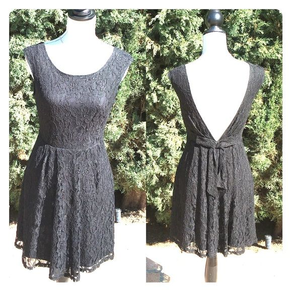 FOREVER 21 Backless Black Lace Cocktail Dress FOREVER 21 Backless Black Lace Cocktail Dress. Deep V back with beautiful subtle bow. Previously loved. As is. In good condition. Forever 21 Dresses Backless