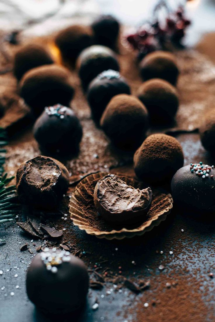 Creamy, boozy, chocolatey. These Easy Chocolate Rum Truffles require just 4 ingredients. No cooking, no baking! Chocolate, butter, rum, cocoa.
