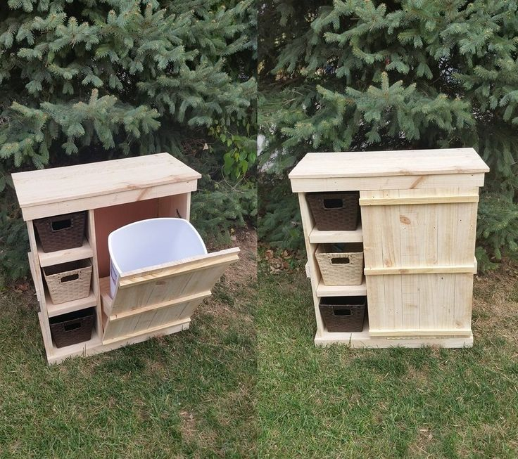 Tilt out trash can with adjustable shelving & baskets from reclaimed pallet lumber.
