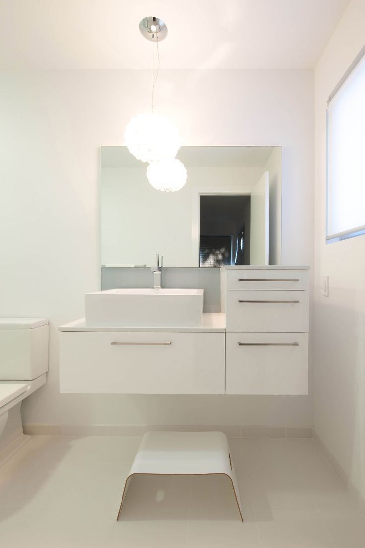 Pure white bathroom scheme everything is white at its finest - Minimalism At Its Finest This Beautiful Bathroom Is Outfitted In A Clean All White Color Scheme Starting With Blizzard Countertops And Extending
