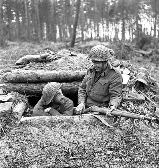 Canadians in Germany - Infantrymen of the Queen's Own Cameron Highlanders of Canada in their dugout in the Hochwald, Germany. March 5, 1945.