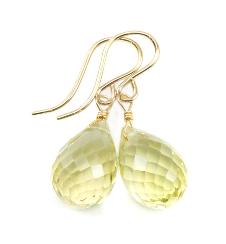 14k Yellow Gold Lemon Yellow Quartz Earrings Faceted Rounded Briolette Teardrops Dangle Style. Soft Lemon Yellow Quartz. Faceted Cut in a rounded Teardrop. Earrings hang 1.1 Inch in length. Mannequin photo shows relative size and how they will hang. High Quality 14k Gold French Earwires.