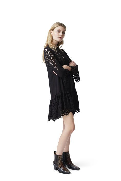 Dress with bell sleeves and pleated bottom  finished with feminin cut outs.