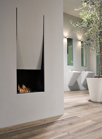 Antonio Lupi | Interesting fireplace. And check out the beautiful basins in the background.