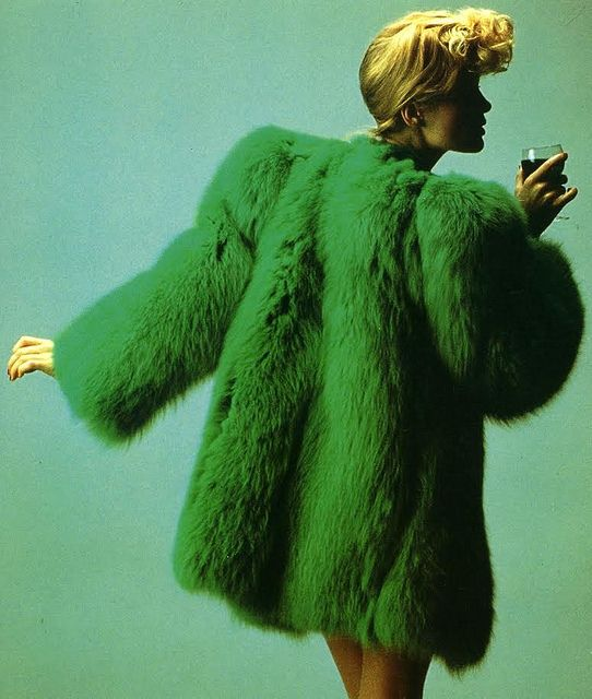 Yves Saint Laurent    Model wears one of the creations of Yves Saint Laurent controversy Collection Fall / Winter 1971,inspired in the 1940's.