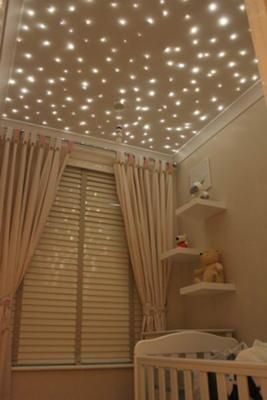 How CUTE is THIS!! Stars twinkle on the ceiling of this baby nursery putting a twist on the traditional moon and stars nursery theme..