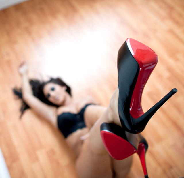 i think she wants red shoes... or red bottom shoes??