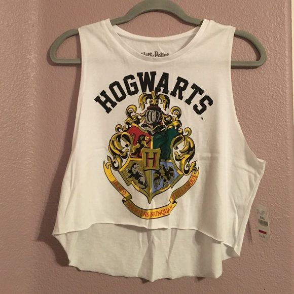Harry Potter Crop Tank NWT crop tank top w/ Hogwarts crest bought at Wet Seal. Super soft material! Muscle-tee style low arm holes. Harry Potter Tops Muscle Tees