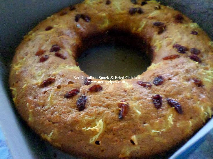 Banana cake with cheese and dry raisins topping