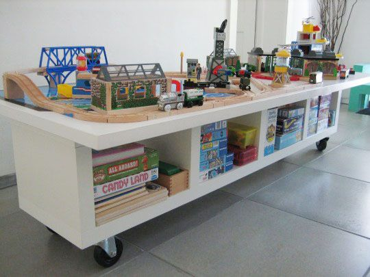 train table - storage combo * be still my heart, for this seems extra long * even though the boys aren't using the trains much these days (they could always resurge!), such a table would be perfect for lego and crafts and elaborate stories that just can't be put away yet...