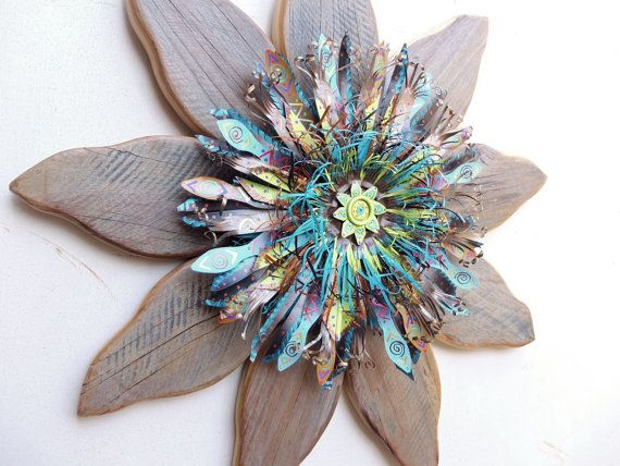 Capturing a rustic yet textural look, this hefty 28 wood and metal wall art flower is a nostalgic and cheery farmhouse decor piece for any time of the year. Flower Title: QUEEN BEE Flower Petal Style: DOROTHY  *28 diameter, with 9 PETALS; 3 deep. *Ready to hang with heavy-duty exterior wire attached. *Indoor/outdoor display. *Wood & metal protected with premium exterior sealant. *Assembled in front and back with exterior screws.  The centerpiece of this rustic home decor flower is made from…