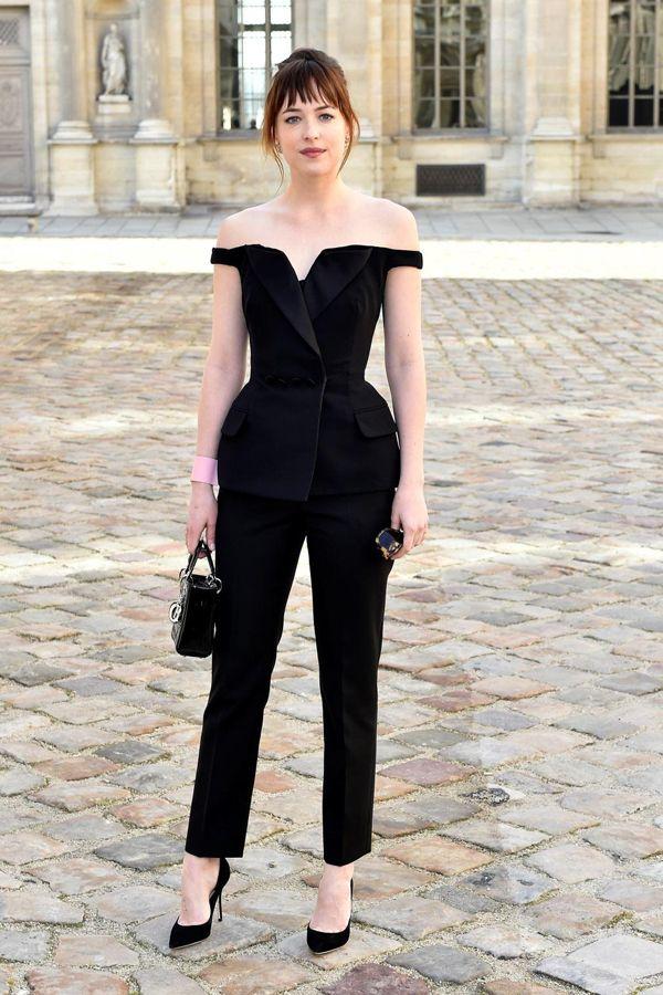 Guest @ Dior FW2015: Dakota Johnson is wearing a black crepe silk Dior smoking with a black crepe silk Dior pants and a black patent Lady Dior bag. #DakotaJohnson #Dior #DiorFW2015 #Guest #ParisFashionWeek
