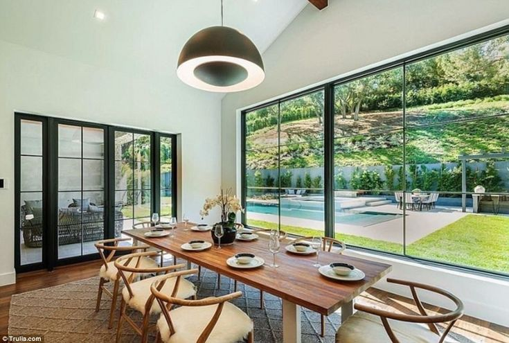 Luxury dining! One table features wooden chairs embellished with sheepskin seat covers and...