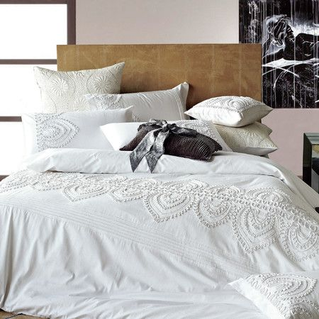 Elegant embroidery gives this lovely cotton duvet cover a lush texture, while its crisp white hue pairs beautifully with any decor.
