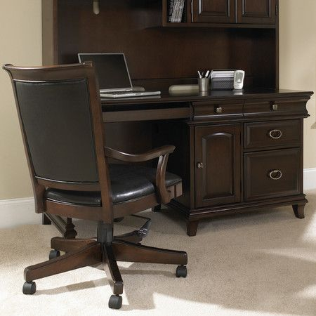 Computer desk with a pull-out keyboard shelf and file drawer. Includes three drawers and a raised panel door.   Product: Computer de...