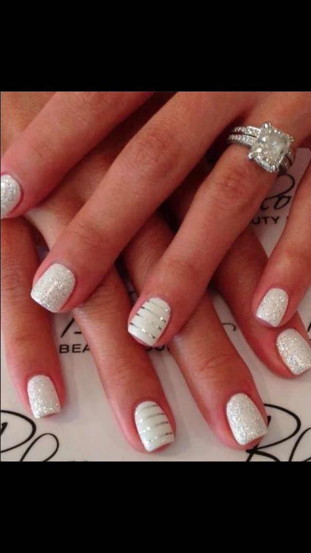 Nail designs. White nail polish with stripes and sparkles. Perfect for wedding, shower, or engagement party or anniversary celebrations