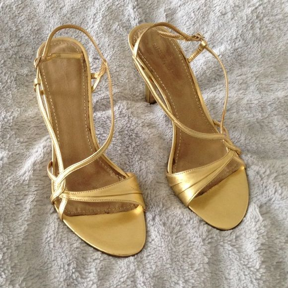 Nine West metallic gold dress sandals Nine West metallic gold dress sandals. Only worn a handful of times to weddings. There is a little something on left sandal that can be cleaned! Size 10M. Nine West Shoes Sandals