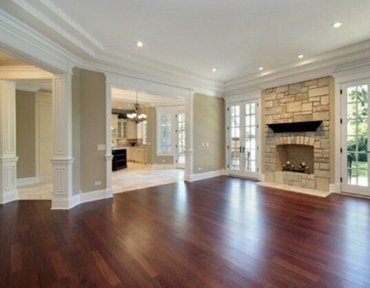 "White trim & crown molding, need lighter ""greige"" wall color, dark hardwood floors meet travertine"