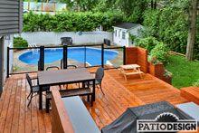 Patio avec piscine creusée par Patio Design inc.