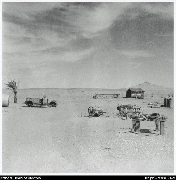 Nolan, Sidney, Sir, 1917-1992. Stock shelter, an old automobile and machinery, Queensland, 1952 [picture]