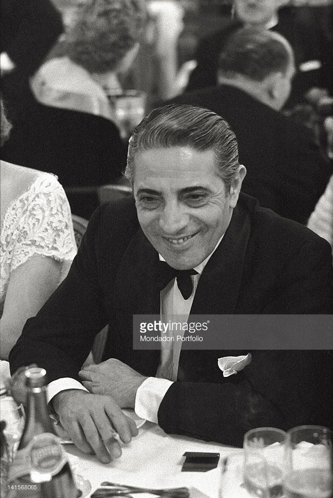 The Greek shipowner Aristotle Onassis photographed smiling and with a cigarette one his fingers, to an elegant dinner in a big restaurant in Montecarlo, by that time his official residence, Onassis docked his own huge yacht 'Christina' on the Principality port. Montecarlo (Principality of Monaco), June 1961