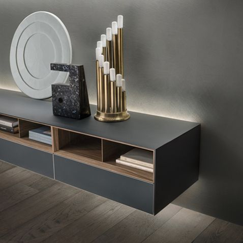 cabinets in matt lacquered grigio ardesia glass with the exclusive LED lighting system and open shelves in walnut.