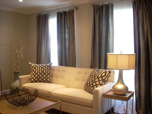 Beige living room with brown 500 375 for What color curtains go with beige walls and dark furniture