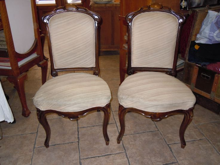 "A PAIR OF CHAIRS in a ""Isabel II"" style."