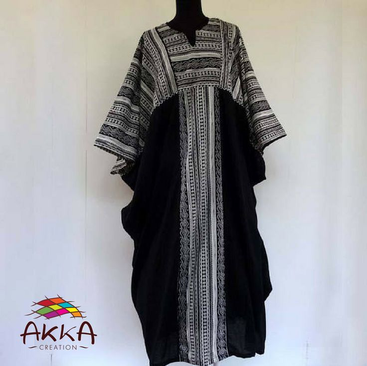Long kaftan tunic in black and white cotton with striped ethnic motifs.  Elegant black and white interior dress in soft and light cotton printed.     #kaftan #tunic #ethnic #elegant #dress #printed #comfortable #greenchristmas