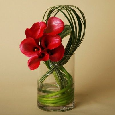 Pink mini callas swirled with variegated lily grass, looped with decorative wire. $49.00