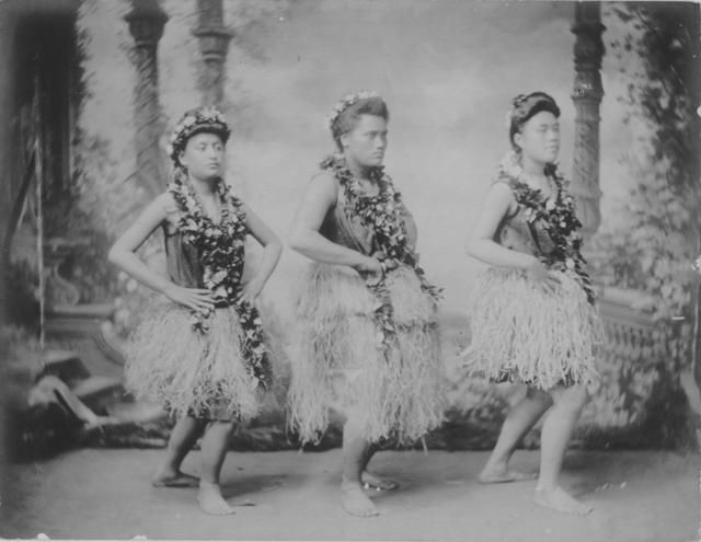 Three hula dancers.